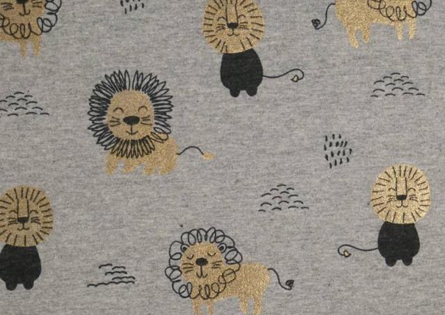 Comprar online Tela de Punto de Camiseta Estampado Dorado Leones
