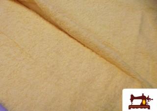 Tela de Rizo Algodón Americano color Amarillo palido.
